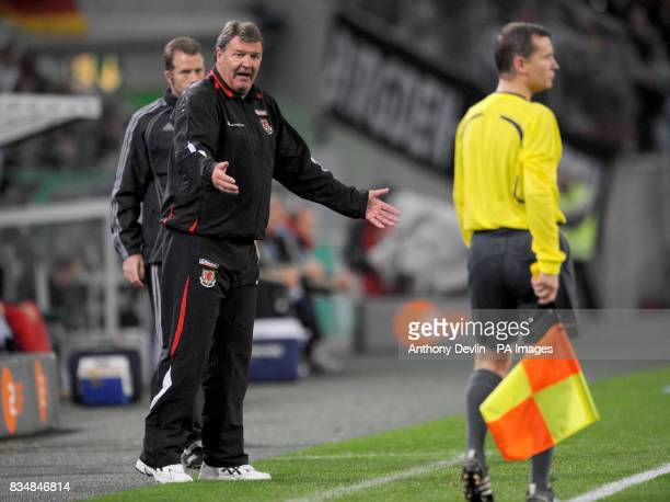 Wales manager John Toshack questions the linesman during the FIFA World Cup Qualifying match at Borussia Park Monchengladbach Germany