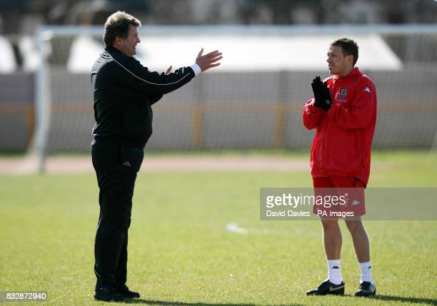 Wales manager John Toshack speaks with Craig Bellamy during a training session at Jenner Park Barry