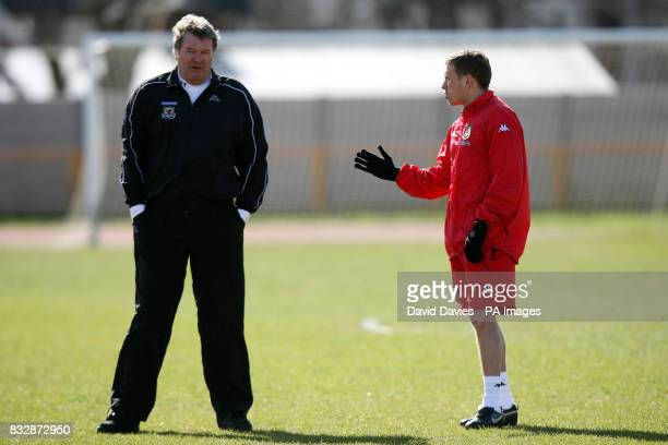 Wales manager John Toshack with Craig Bellamy during a training session at Jenner Park Barry
