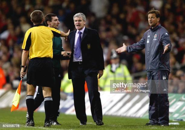Wales manager Mark Hughes argues with the linesman and fourth official during the World Cup qualifier against Poland at the Millennium Stadium...