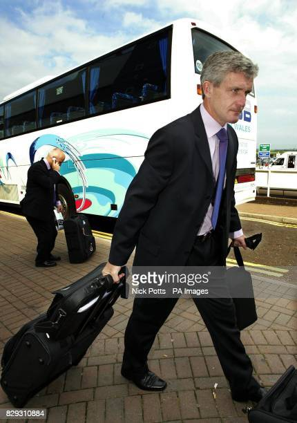 Wales Manager Mark Hughes arrives at Cardiff airport as they depart for Baku ahead of their first World Cup qualifying match against Azerbaijan