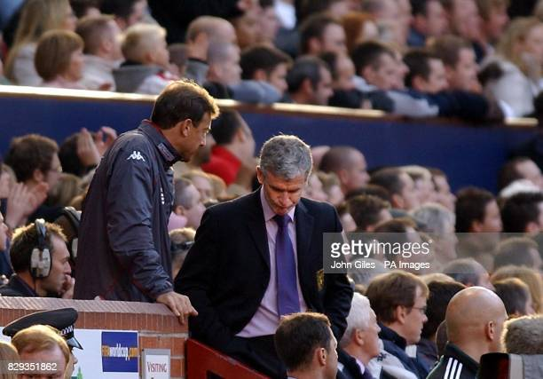 Wales Manager Mark Hughes looks dejected as his side are beaten by England in their World Cup qualifying Group six match at Old Trafford Manchester...