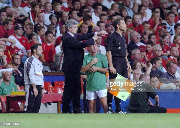 Wales' manager Mark Hughes points to his watch during the World Cup qualifier against Northern Ireland in Cardiff Final score Wales 22 Northern...