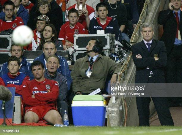 Wales' Manager Mark Hughes stands watching with dejection with captain Gary Speed on the bench during the World Cup qualifier at the Millennium...