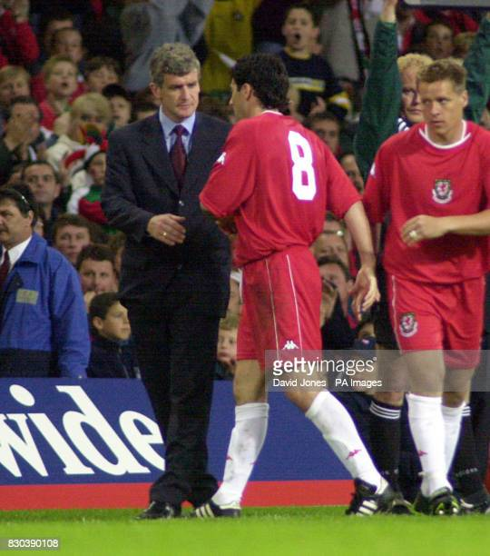 Wales manager Mark Hughes substitutes Dean Saunders during the second half of the friendly international match against Brazil at the Millennium...