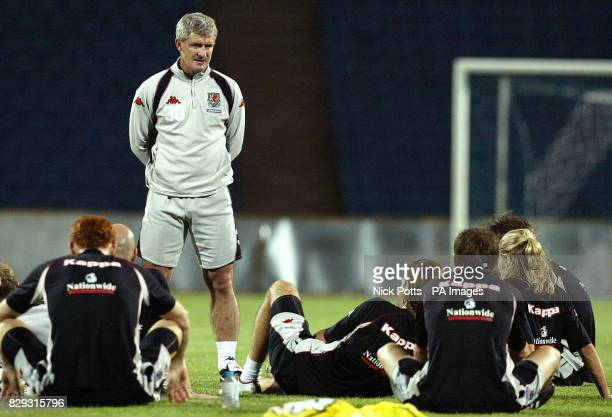 Wales manager Mark Hughes talks to his players during a training session at Respublika Stadium in Baku Azerbaijan prior to playing Azerbaijan in...