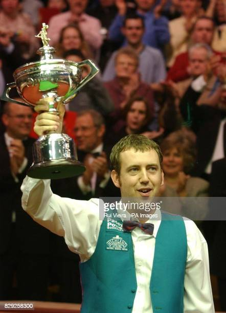 Wales Mark Williams shows the trophy after beating Ireland's Ken Doherty by 18 16 frames in the the Embassy World Snooker Final at The Crucible...