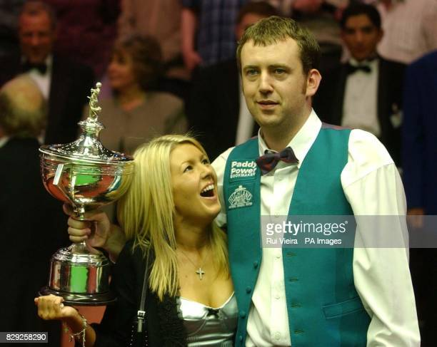 Wales Mark Williams shows the trophy with girlfriend Joanne Dent after beating Ireland's Ken Doherty by 18 16 frames in the the Embassy World Snooker...