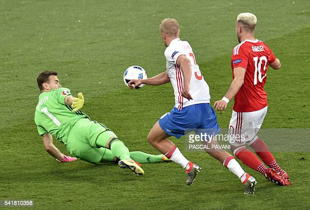 Wales' midfielder Aaron Ramsey shoots to score during the Euro 2016 group B football match between Russia and Wales at the Stadium Municipal in...