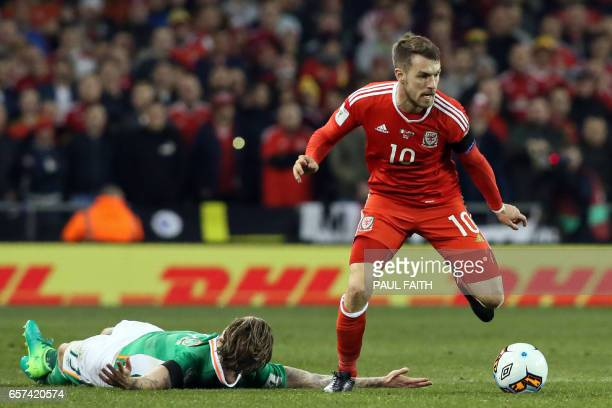 Wales' midfielder Aaron Ramsey takes the ball from Republic of Ireland's midfielder Jeff Hendrick during the World Cup 2018 qualification football...