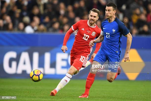 Wales' midfielder Aaron Ramsey vies for the ball with France's defender Laurent Koscielny during the friendly football match between France and Wales...