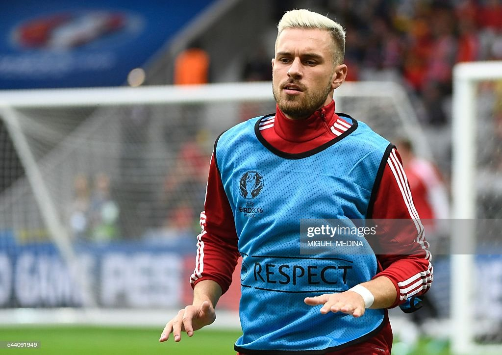 Wales' midfielder Aaron Ramsey warms up ahead of the Euro 2016 quarter-final football match between Wales and Belgium at the Pierre-Mauroy stadium in Villeneuve-d'Ascq near Lille, on July 1, 2016. / AFP / MIGUEL