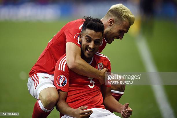 TOPSHOT Wales' midfielder Aaron Ramsey who scored the first goal celebrates with Wales' defender Neil Taylor who scored the team's second goal during...