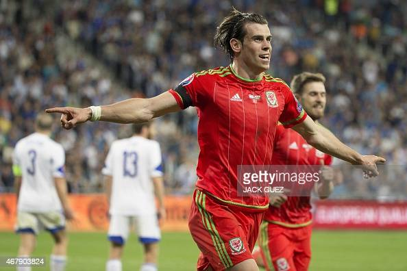 Wales' midfielder Gareth Bale celebrates his goal during the Euro 2016 qualifying football match between Israel and Wales at the Sammy Ofer Stadium...