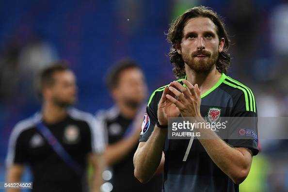 Wales' midfielder Joe Allen reacts at the end of the Euro 2016 semifinal football match between Portugal and Wales at the Parc Olympique Lyonnais...