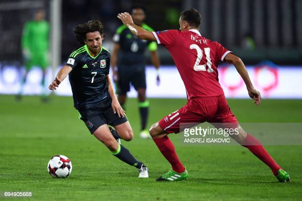 Wales' midfielder Joe Allen vies for the ball with Serbia's midfielder Nemanja Matic during the FIFA World Cup 2018 qualification football match...