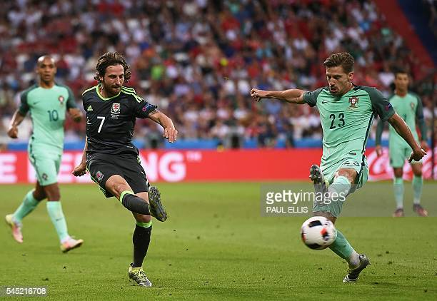 Wales' midfielder Joe Allen vies with Portugal's midfielder Adrien Silva during the Euro 2016 semifinal football match between Portugal and Wales at...