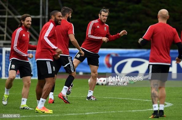 Wales' midfielder Joe Allen Wales' defender Ashley Richards Wales' midfielder Joe Ledley and Wales' forward Gareth Bale take part in a training...