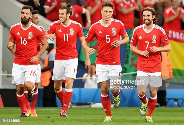 Wales' midfielder Joe Ledley Wales' forward Gareth Bale Wales' defender James Chester Wales' midfielder Joe Allen celebrate a team goal during the...