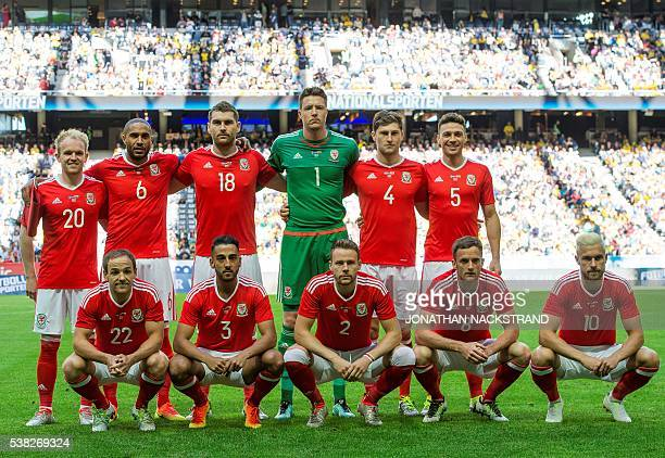 Wales' midfielder Jonathan Williams defender and team captain Ashley Williams forward Sam Vokes goalkeeper Wayne Hennesey defender Ben Davies and...