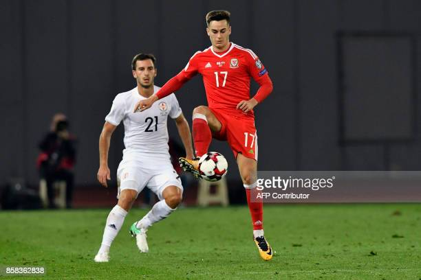 Wales' midfielder Tom Lawrence controls the ball next to Georgia's defender Otar Kakabadze during the FIFA World Cup 2018 qualification football...