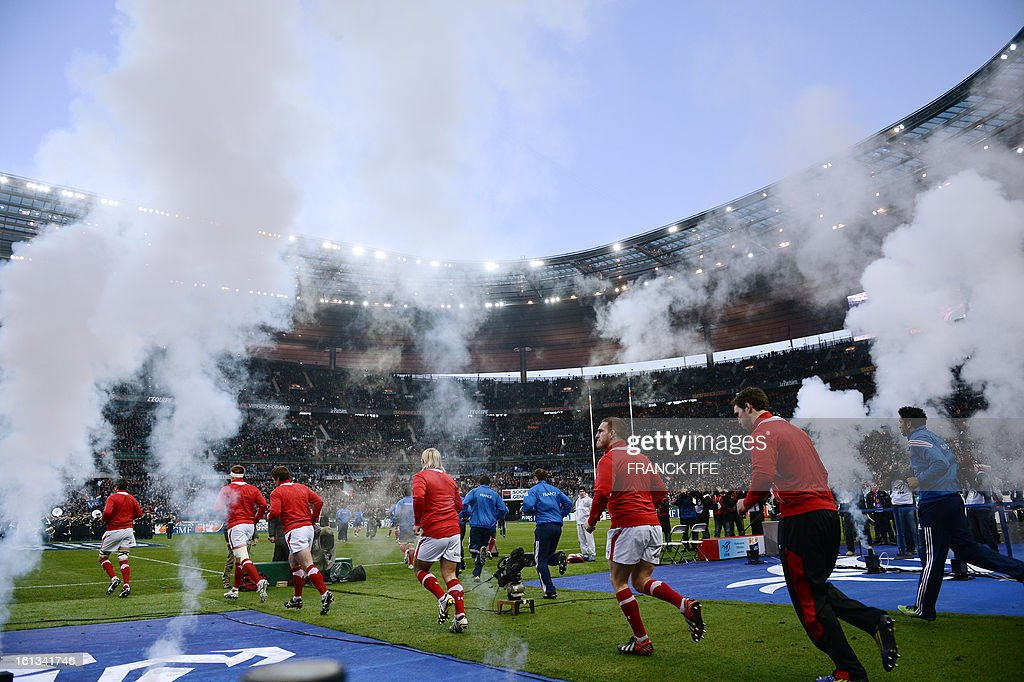 Wales' national rugby team enter the field before the Six Nations Rugby Union match between France and Wales at the Stade de France on February 9, 2013 in Saint-Denis, near Paris.