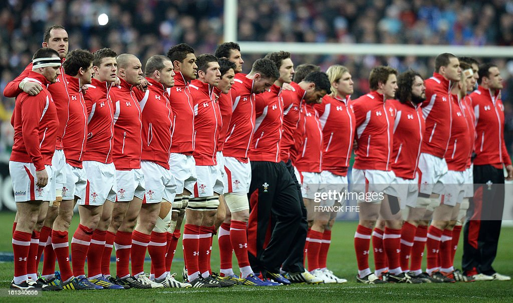Wales' national rugby team stand on the field before the Six Nations Rugby Union match between France and Wales at the Stade de France on February 9, 2013 in Saint-Denis, near Paris.