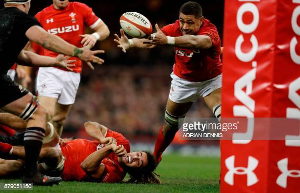 TOPSHOT Wales' number 8 Taulupe Faletau stretches for a loose ball during the Autumn international rugby union Test match between Wales and New...