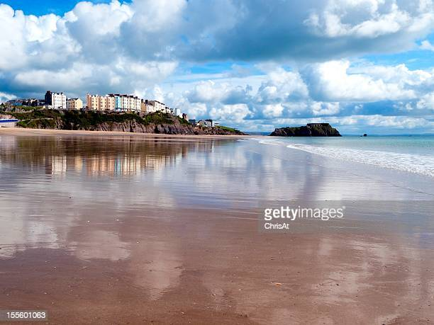 Wales, Pembrokeshire, Tenby reflected in wet sand, South Beach