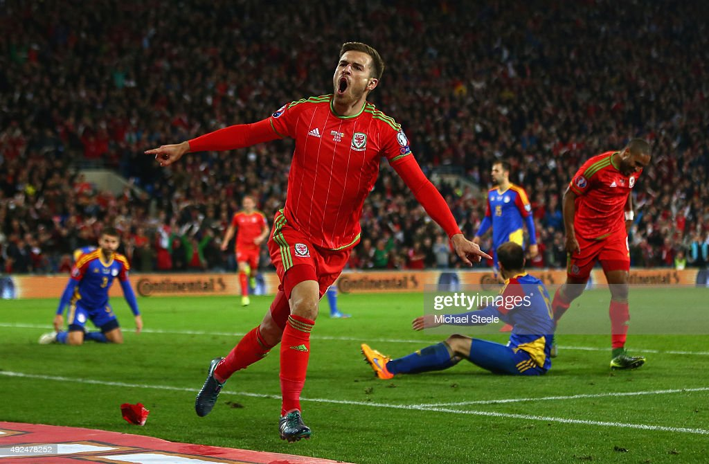 Wales player <a gi-track='captionPersonalityLinkClicked' href=/galleries/search?phrase=Aaron+Ramsey&family=editorial&specificpeople=4784114 ng-click='$event.stopPropagation()'>Aaron Ramsey</a> celebrates after scoring the first goal during the UEFA EURO 2016 Group B Qualifier between Wales and Andorra at Cardiff City stadium on October 13, 2015 in Cardiff, United Kingdom.