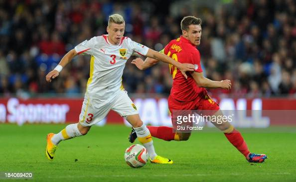 Wales player Aaron Ramsey challenges Ezgjan Alioski of Macedonia during the FIFA 2014 World Cup Qualifier Group D match between Wales and Macedonia...