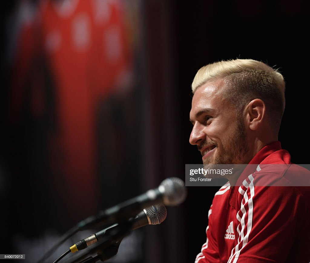 Wales player <a gi-track='captionPersonalityLinkClicked' href=/galleries/search?phrase=Aaron+Ramsey+-+Soccer+Player&family=editorial&specificpeople=4784114 ng-click='$event.stopPropagation()'>Aaron Ramsey</a> faces the media during the Wales press conference at their Euro 2016 base on June 14, 2016 in Dinard, France.