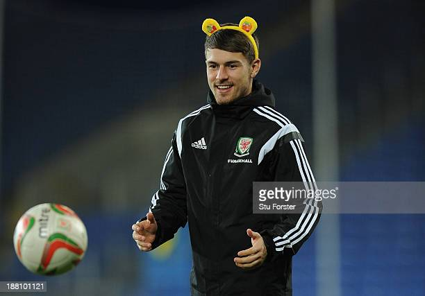 Wales player Aaron Ramsey in action with a set of Pudsey ears part of the Children in Need Charity campaign during Wales training ahead of their...