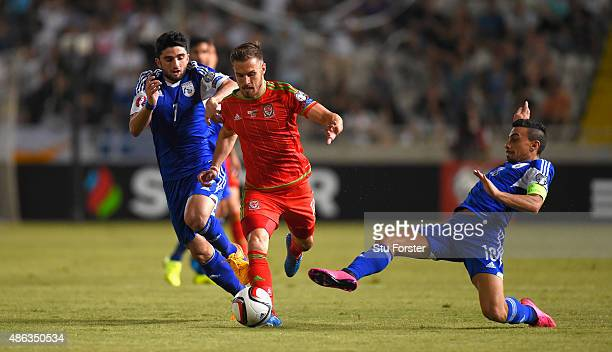 Wales player Aaron Ramsey rides the challenge of Constantinos Charalambides of Cyprus during the UEFA EURO 2016 Qualifier between Cyprus and Wales at...