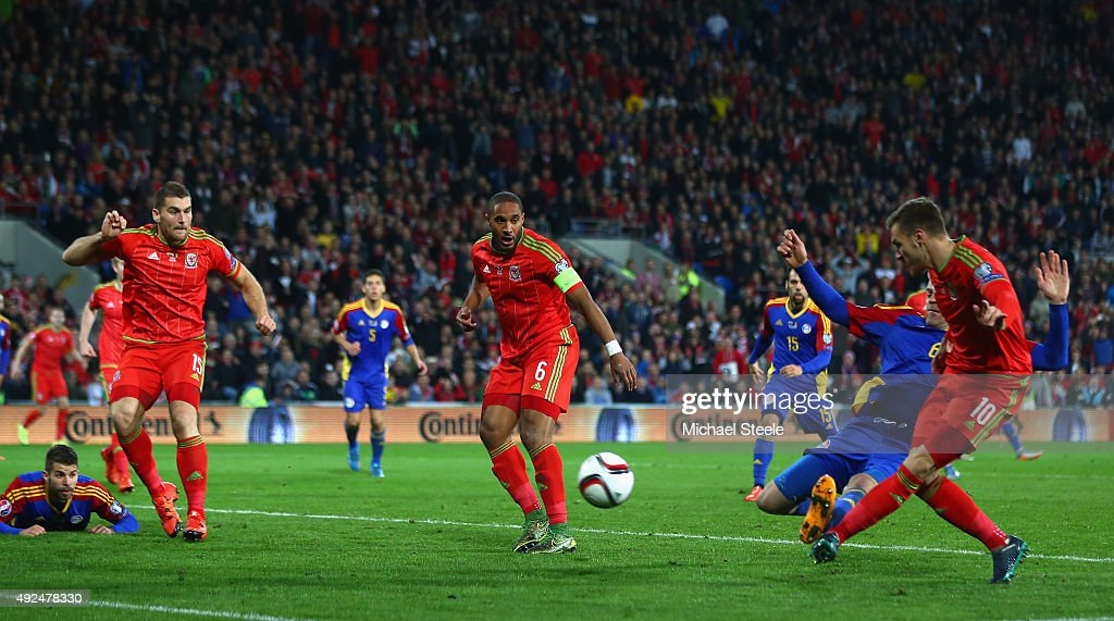 Wales player Aaron Ramsey scores the first goal during the UEFA EURO 2016 Group B Qualifier between Wales and Andorra at Cardiff City stadium on...