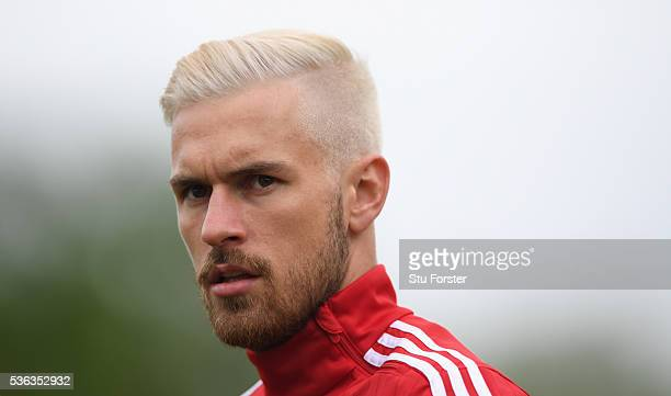 Wales player Aaron Ramsey with new hairstyle looks on during Wales training at the Vale hotel complex on June 1 2016 in Cardiff Wales
