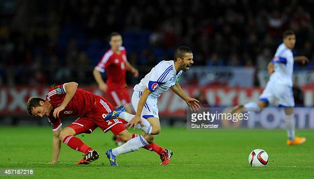 Wales player Andy King fouls Constantinos Makridis of Cyprus and receives a red card during the EURO 2016 Qualifier match between Wales and Cyprus at...
