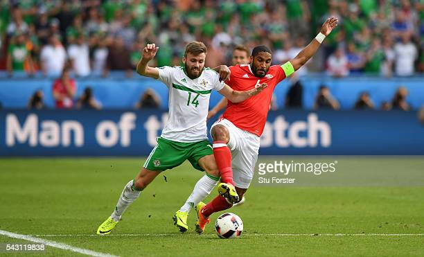 Wales player Ashley Williams is challenged by Stuart Dallas of Northern Ireland the Round of 16 UEFA Euro 2016 match between Wales and Northern...