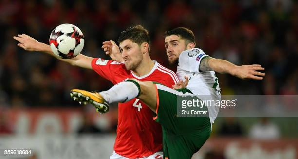 Wales player Ben Davies is challenged by Robbie Brady of Ireland during the FIFA 2018 World Cup Qualifier between Wales and Republic of Ireland at...