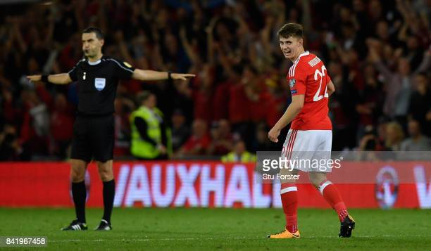 Wales player Ben Woodburn celebrates as the referee blows the final whistle after the FIFA 2018 World Cup Qualifier between Wales and Austria at...