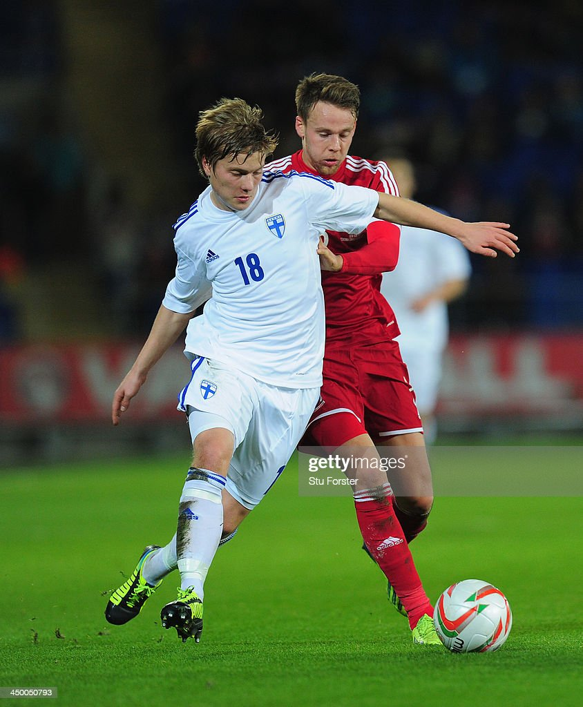 Wales player Chris Gunter (r) challenges Jere Uronen of Finland during the International Friendly match between Wales and Finland at Cardiff City Stadium on November 16, 2013 in Cardiff, Wales.
