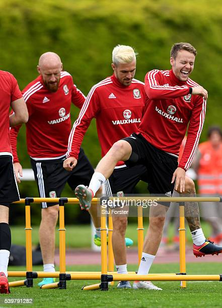 Wales player Chris Gunter shares a joke with Aaron Ramsey and James Collins during Wales training at their Euro 2016 base camp on June 13 2016 in...