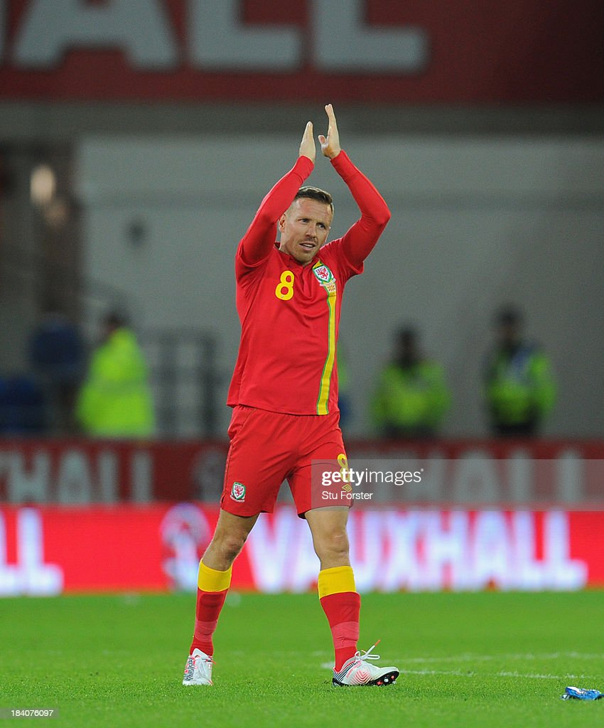 Wales player <a gi-track='captionPersonalityLinkClicked' href=/galleries/search?phrase=Craig+Bellamy+-+Soccer+Player&family=editorial&specificpeople=203318 ng-click='$event.stopPropagation()'>Craig Bellamy</a> applauds the crowd after his last home appearance after the FIFA 2014 World Cup Qualifier Group D match between Wales and Macedonia at Cardiff City Stadium on October 11, 2013 in Cardiff, Wales.