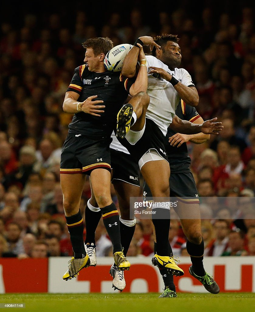 Wales player Dan Biggar and Fiji fullback Metuisela Talebula compete for a high ball during the 2015 Rugby World Cup Pool A match between Wales and...