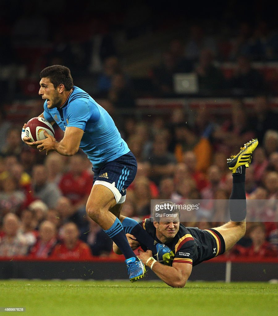 Wales player Dan Biggar attempts to tackle Giovanbattista Venditti of Italy during the International match between Wales and Ireland at Millennium...