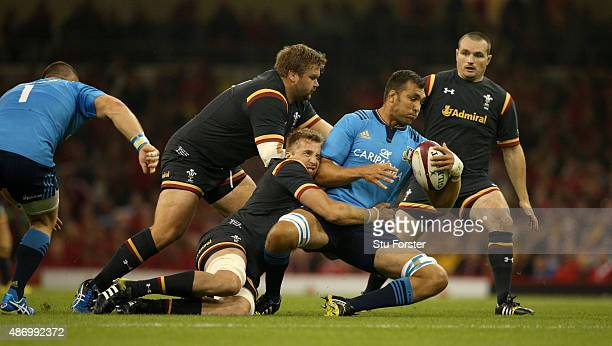 Wales player Dominic Day tackles Quintin Geldenhuys of Italy during the International match between Wales and Ireland at Millennium Stadium on...