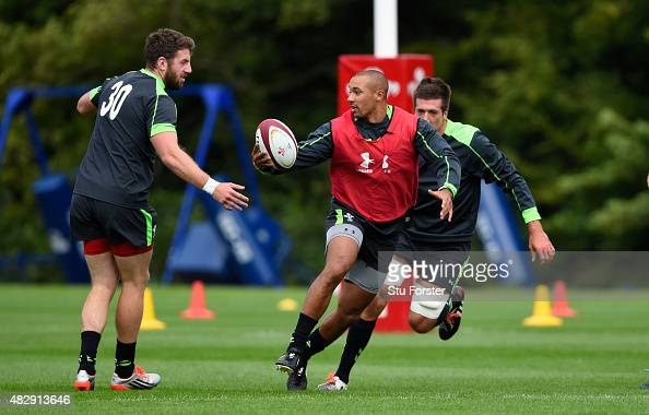 Wales player Eli Walker runs through the tackles of Alex Cuthbert and Justin Tipuric during Wales training ahead of saturdays World cup warm up match...