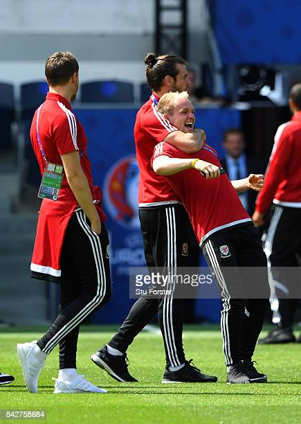 Wales player Gareth Bale and Jonny Williams share a joke during Wales Open Session prior to their Euro 2016 match against Northern Ireland at Parc...