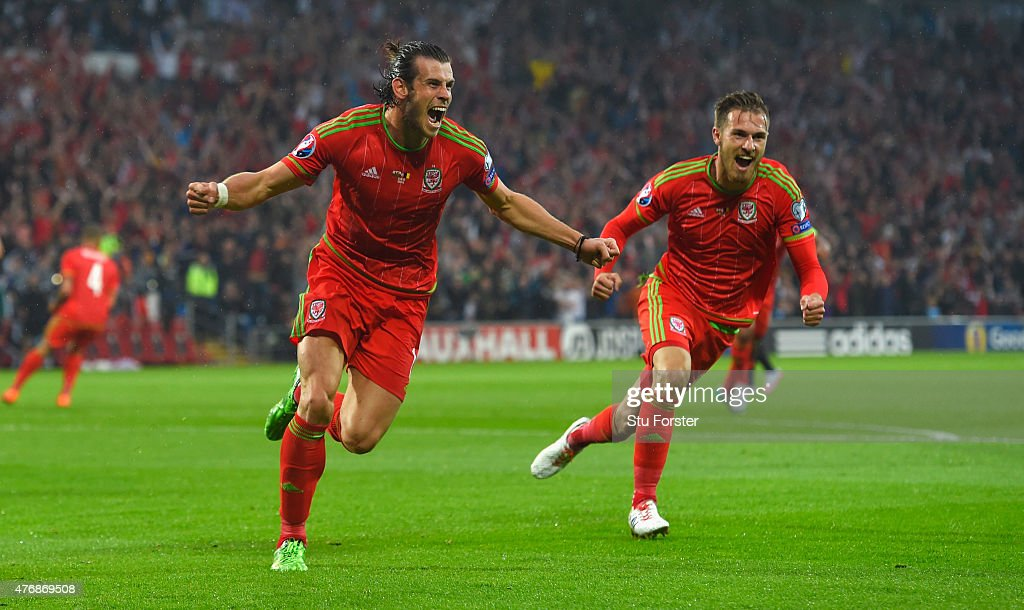 Wales player <a gi-track='captionPersonalityLinkClicked' href=/galleries/search?phrase=Gareth+Bale&family=editorial&specificpeople=609290 ng-click='$event.stopPropagation()'>Gareth Bale</a> celebrates after scoring the opening goal during the UEFA EURO Group B 2016 Qualifier between Wales and Belguim at Cardiff City stadium on June 12, 2015 in Cardiff, United Kingdom.