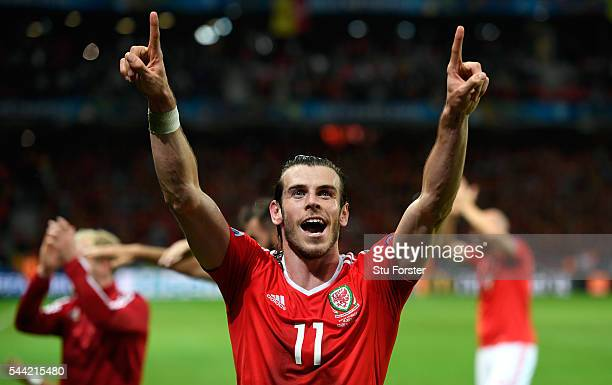 Wales player Gareth Bale celebrates after the UEFA Euro 2016 Quarter Final match between Wales and Belguim at Stade PierreMauroy on July 1 2016 in...